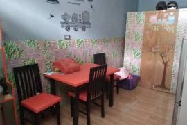 Ruang makan,kipas angin,ada meja setrika, setrika, Mesin cuci,kulkas