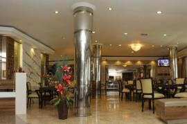 Kost executive tengah kota dengan fasilitas hotel berbintang